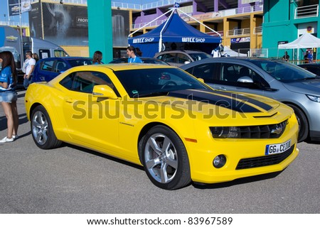 VALENCIA, SPAIN - SEPT 3: A 2011 Chevrolet Camaro from the movie Transformers, Autobot Bumble Bee, on display at the FIA World Touring Car Championship on September 3, 2011 in Valencia, Spain.