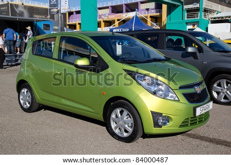 VALENCIA, SPAIN - SEPT 3: A 2011 Chevrolet Spark on display at the FIA World Touring Car Championship on September 3, 2011 in Valencia, Spain.  The Spark is a compact car sold in Europe. - stock photo