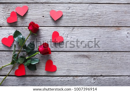 Valentine Background With Red Rose Flowers And Handmade Paper Hearts On Grey Rustic Wood Copy