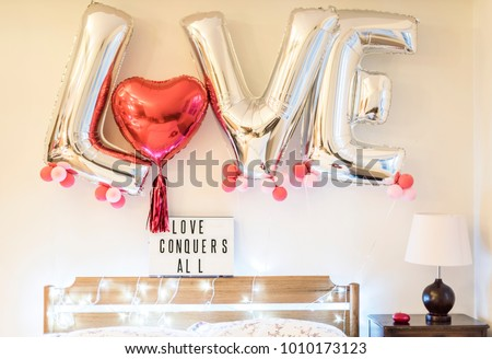 Valentine celebration balloon by the wall