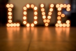 Valentine day and christmas background. Blurred word Love for valentine day and merry  christmas