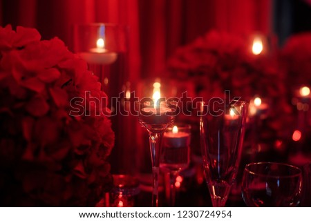Valentine dinner setup with roses and candles