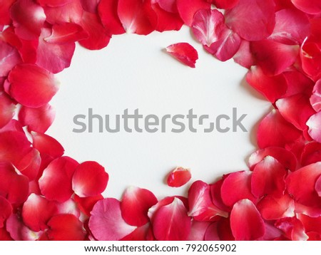 Valentine frame of rose petals with white center space for text ...