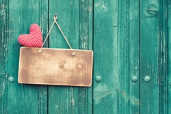 Valentine heart and sign board on wooden vintage background
