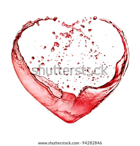 Valentine heart from red wine isolated on white background