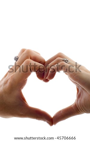 stock photo : Valentine: Love - Heart shape being made by a couple, female