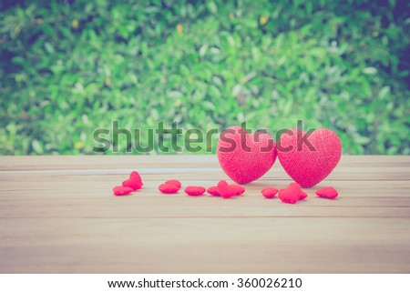 Valentine red heart shaped on wooden table for background, Vintage Style. #360026210