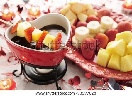 Valentine's chocolate fondue with pineapple, strawberries, bananas