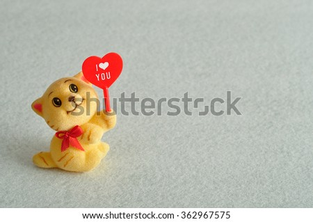 Valentine's day. A kitten figurine holding a red heart with the word i love you #362967575