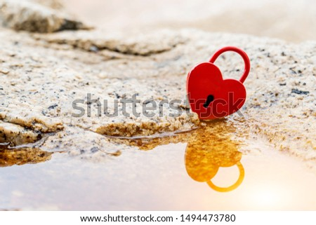 Valentine's Day and love concept with heart shaped padlock. Sweetest key and romance symbol. #1494473780