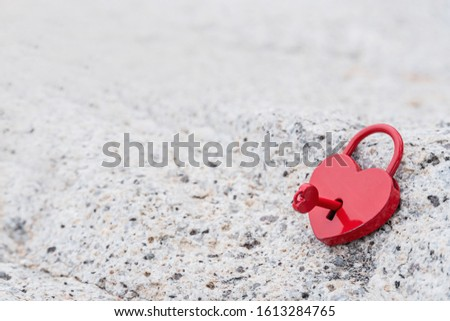 Valentine's Day and love concept with heart shaped padlock. Sweetest key and romance symbol.