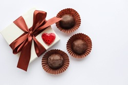 valentine's day background. gift box, red heart and chocolates