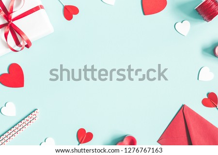 Valentine's Day background. Gifts, candle, confetti, envelope on pastel blue background. Valentines day concept. Flat lay, top view, copy space Stockfoto ©