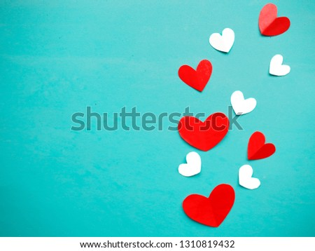 Valentine's Day background. Red and white hearts on bright blue background. Valentines day concept. Flat lay, top view, copy space #1310819432