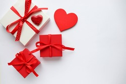 valentine's day background. valentine's day gift concept. gift box on a white background and a red heart.