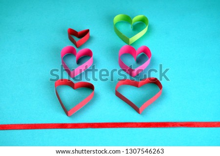 Valentine's Day background ,with paper heart shape, with ribbon and bow, Concept Celebrating festival symbolizes day of love, Anniversary, Mother's day and birthday greeting. Space for text, top view  #1307546263