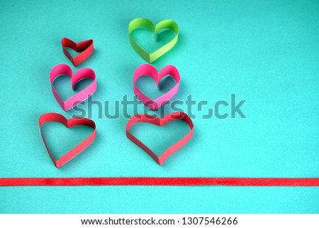 Valentine's Day background ,with paper heart shape, with ribbon and bow, Concept Celebrating festival symbolizes day of love, Anniversary, Mother's day and birthday greeting. Space for text, top view  #1307546266