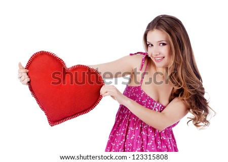 Valentine's Day. Beautiful smiling woman with heart in his hands