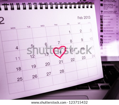 Valentine's Day Calendar on notebook computer in real office.
