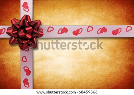 valentine's day card. ribbon with bow on grunge background