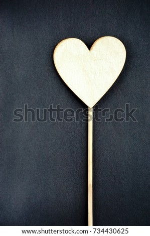 Valentine's day card. Wooden heart with free copy space on black background.  Still life. #734430625