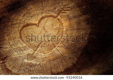 Valentine\'s day concept background with copyspace.  Love text on  wooden background