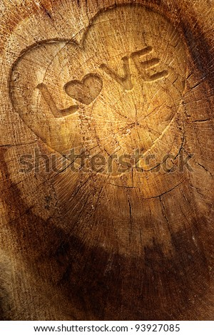Valentine's day concept background with copyspace.  Love text on  wooden background