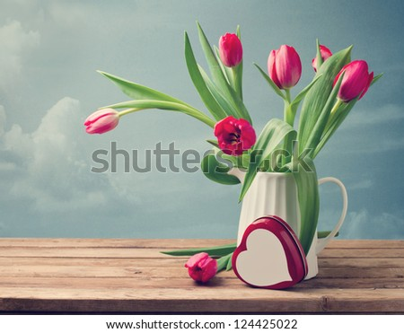 Valentine\'s Day concept. Beautiful tulip bouquet with heart shape box