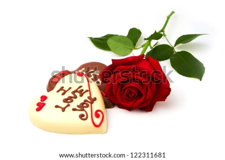 Valentine's Day concept. Heart shape chocolate and red rose on white background