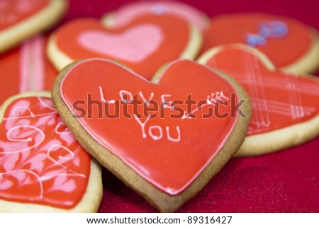 valentine's day cookies on a red background - stock photo
