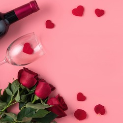 Valentine's Day dating gift with wine and rose concept on pink background design concept