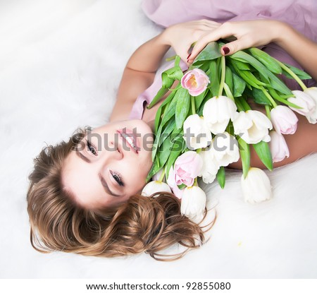 Valentine's Day - Dreaming Voluptuous Young Woman with Bouquet of Flowers. Series of photos
