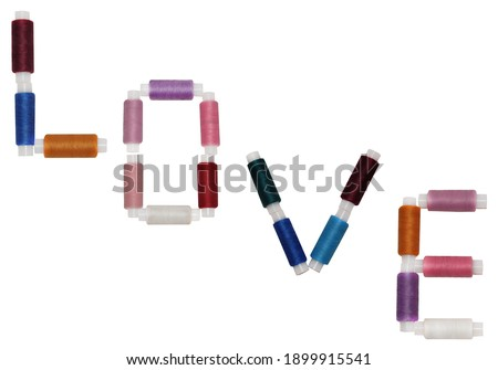 valentine's day for lovers of sewing and embroidery. The word love from threads on an isolated white background Stok fotoğraf ©