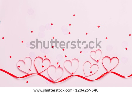 Valentine's day greeting card with beautiful pure pink hearts and confetti. Lovely Happy Valentine's day minimal concept. top view, flat lay.