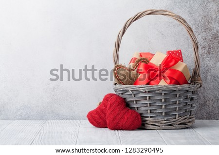Valentine's day greeting card with gift boxes in basket. With space for your greetings Stock photo ©