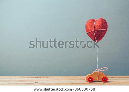 Valentine\'s day holiday celebration with toy car and heart shape