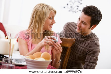 Valentine\'s Day holiday series with young Caucasian couple enjoying a romantic dinner together.