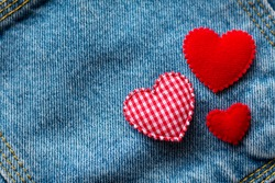 Valentine's Day. jeans background with red heart.