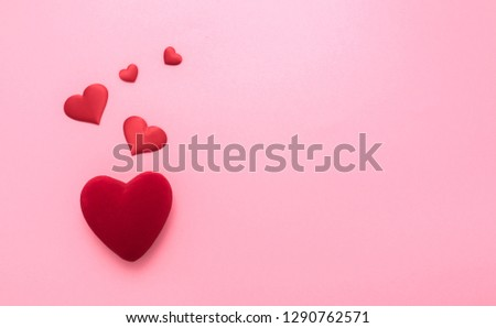 Valentine's Day. Love background. Gifts in the form of hearts on a pink background with the inscription love. Copy space for text. The concept of romance and love.  #1290762571