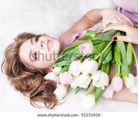 Valentine s  day (or birthday) - dreamy lovely young girl with gift - bouquet of fresh tulips.