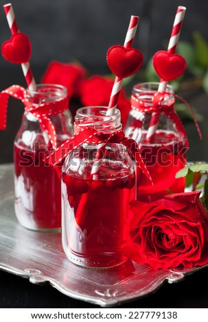Valentine\'s Day party idea:individual small bottles with cranberry cocktail