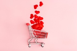 valentine's day pink background, grocery cart and red heart, top view, minimalism