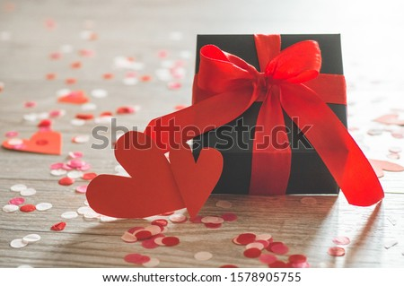 Valentine's Day postcard. Love concept for mother's day and valentine's day. Happy Valentine's day hearts on wooden background. Valentine card with space for text