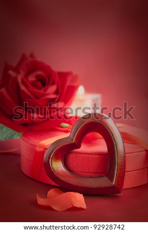 Valentine's day red heart on luxury present candle and copyspace
