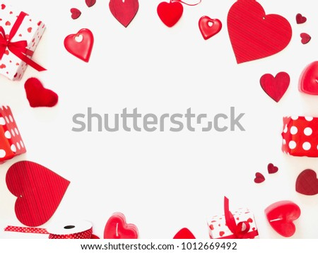 Valentine's day red hearts.Happy Valentine's day, background. Frame made of different hearts, gifts, candles on a white background. Love concept. Flat lay, top view, copy space #1012669492
