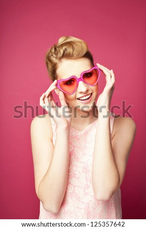 Valentine's day. Retro woman with heart sunglasses.