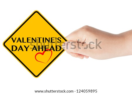 Valentine's Day traffic sign in woman's hand on a white background