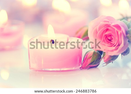 Valentine\'s Day. Valentine Gift. Pink Heart shaped candles and rose flowers on white wooden background. Beautiful Valentine card art design