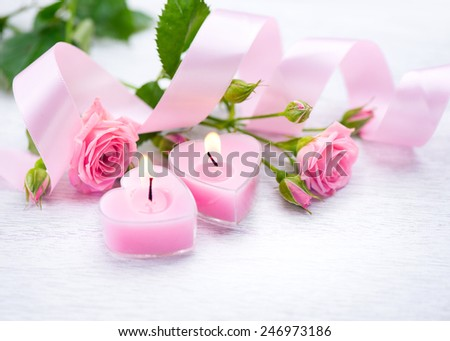 Valentine's Day Valentine Gift Pink Heart shaped candles and rose flowers on white wooden background Beautiful Valentine card art design