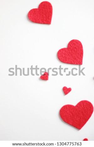 Valentine's Day. Valentine's Day Handmade Red Textile Hearts over white background. Valentine's Day Holiday Background with hearts. Wedding celebrating.